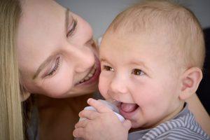 Joyful mother and baby